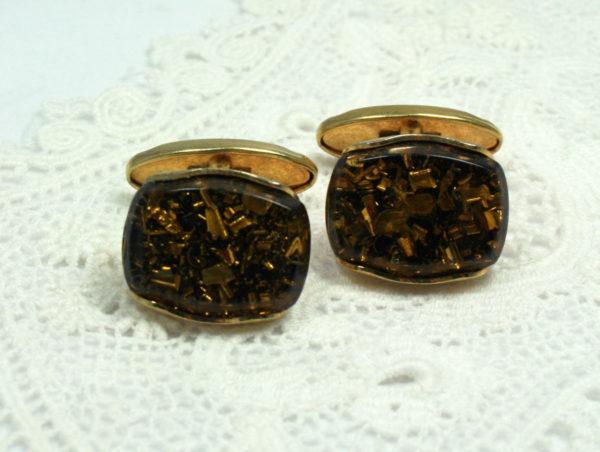 Elegante manchetknopen in goud en bruin