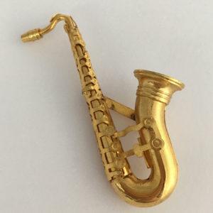 Saxofoon broche goudkleurig