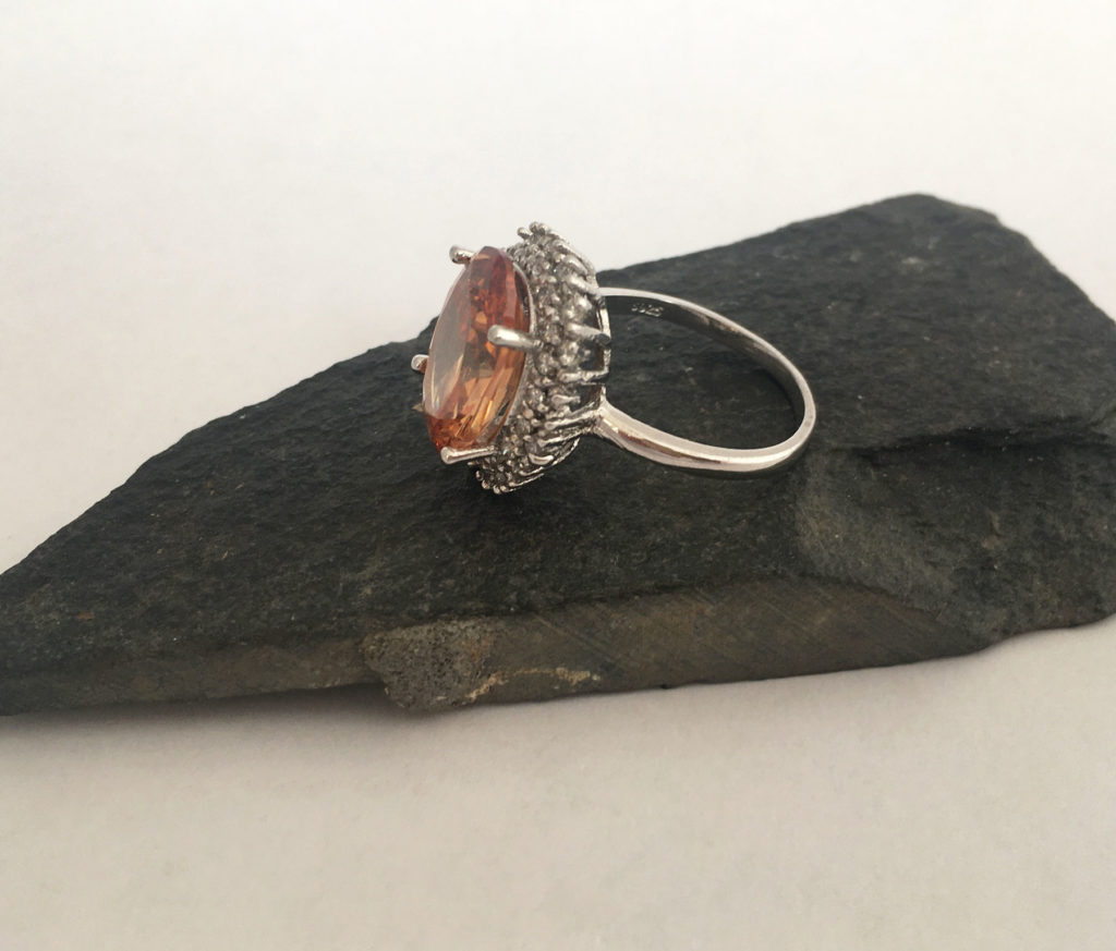 zilveren ring met oranje steen