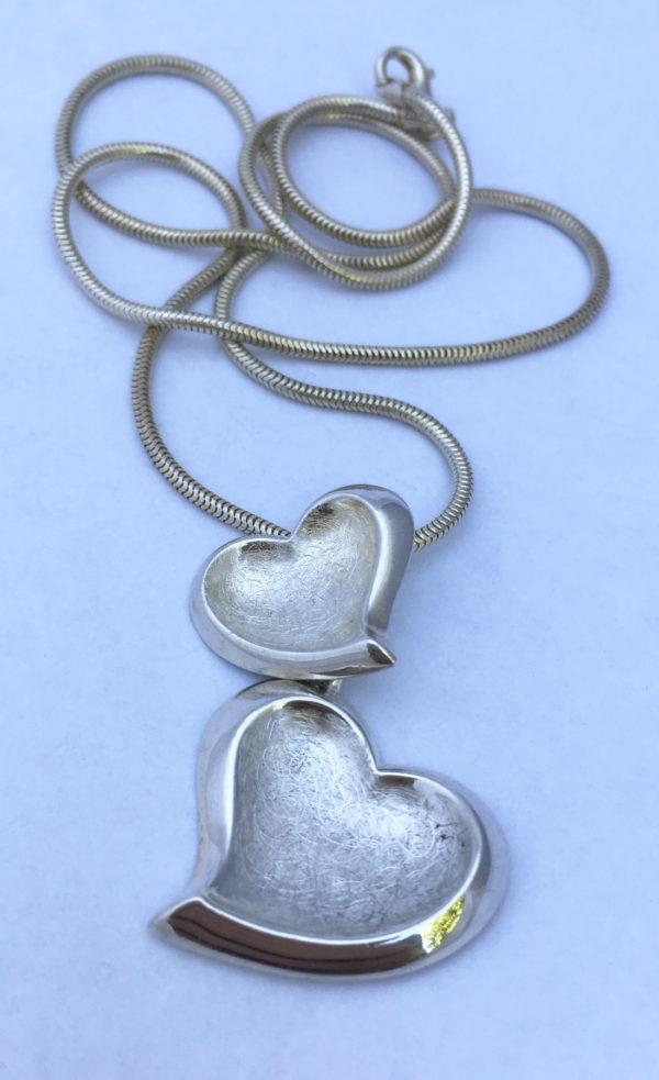 zilveren hanger met hartjes