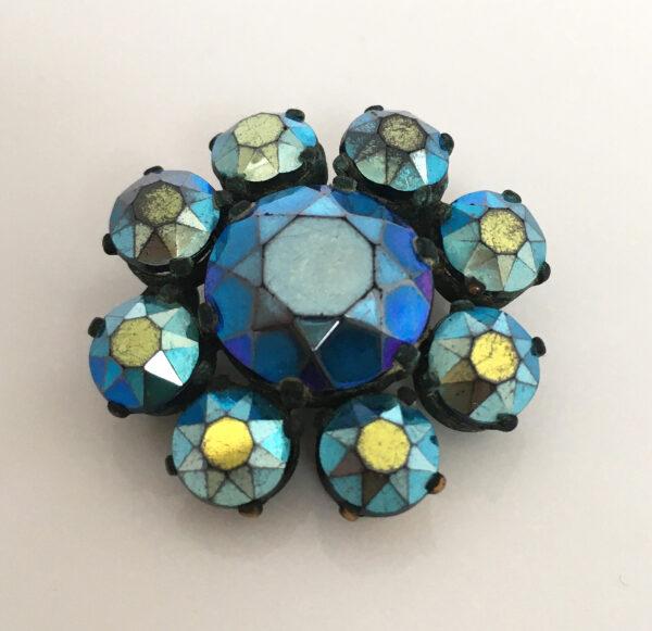 Blauwe 50s broche met aurora borealis