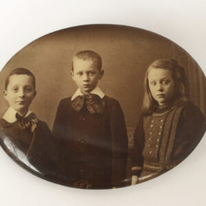 Celluloid portret broche kinderen