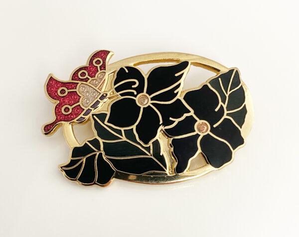 cloisonné broche met bloemen en vlinder