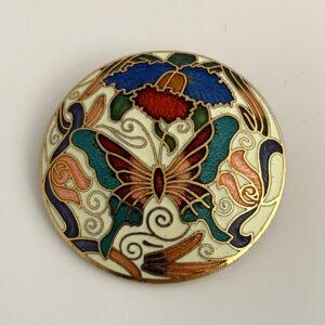 ronde cloisonne broche met vlinder en bloemen