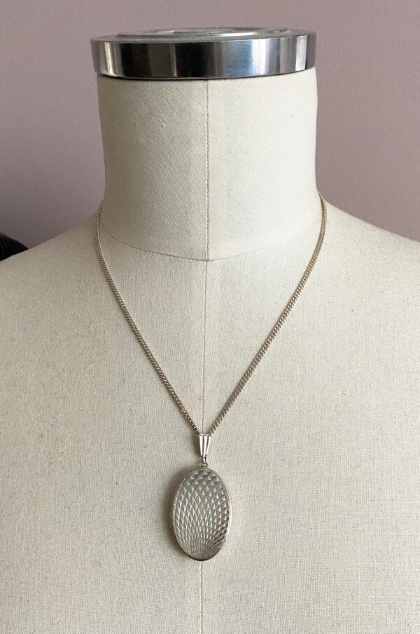 zilveren medaillon sunburst patroon
