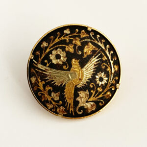Damascene broche met vogel
